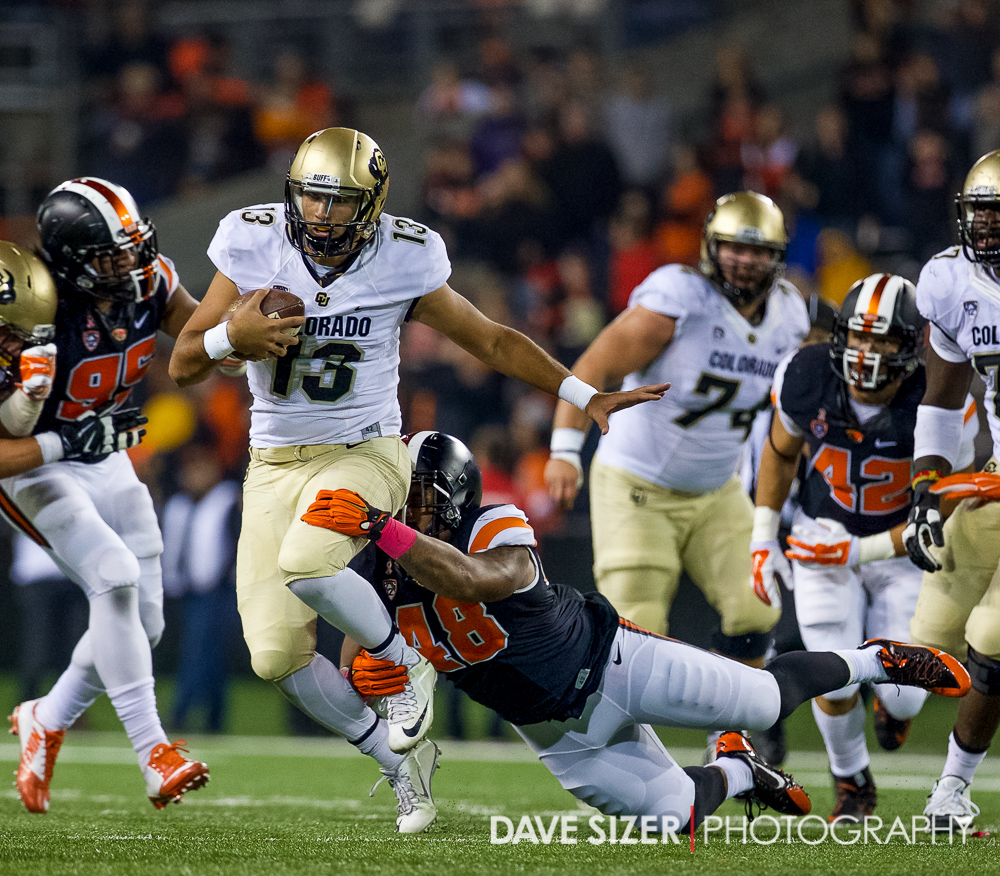 Colorado QB Sefo Lirufau scrambles for yards.