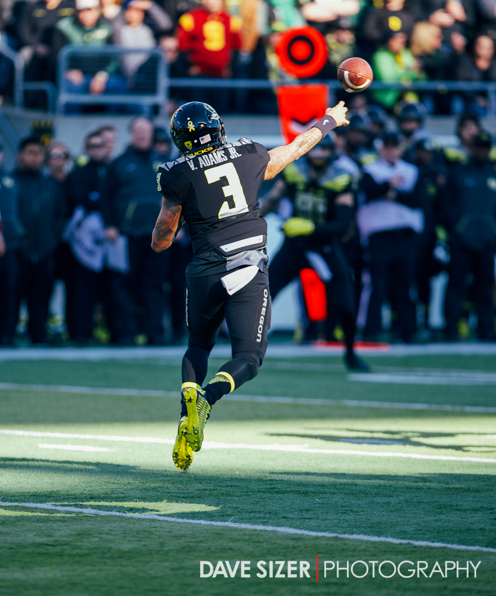 Vernon Adams unloads a pass into the shadows.