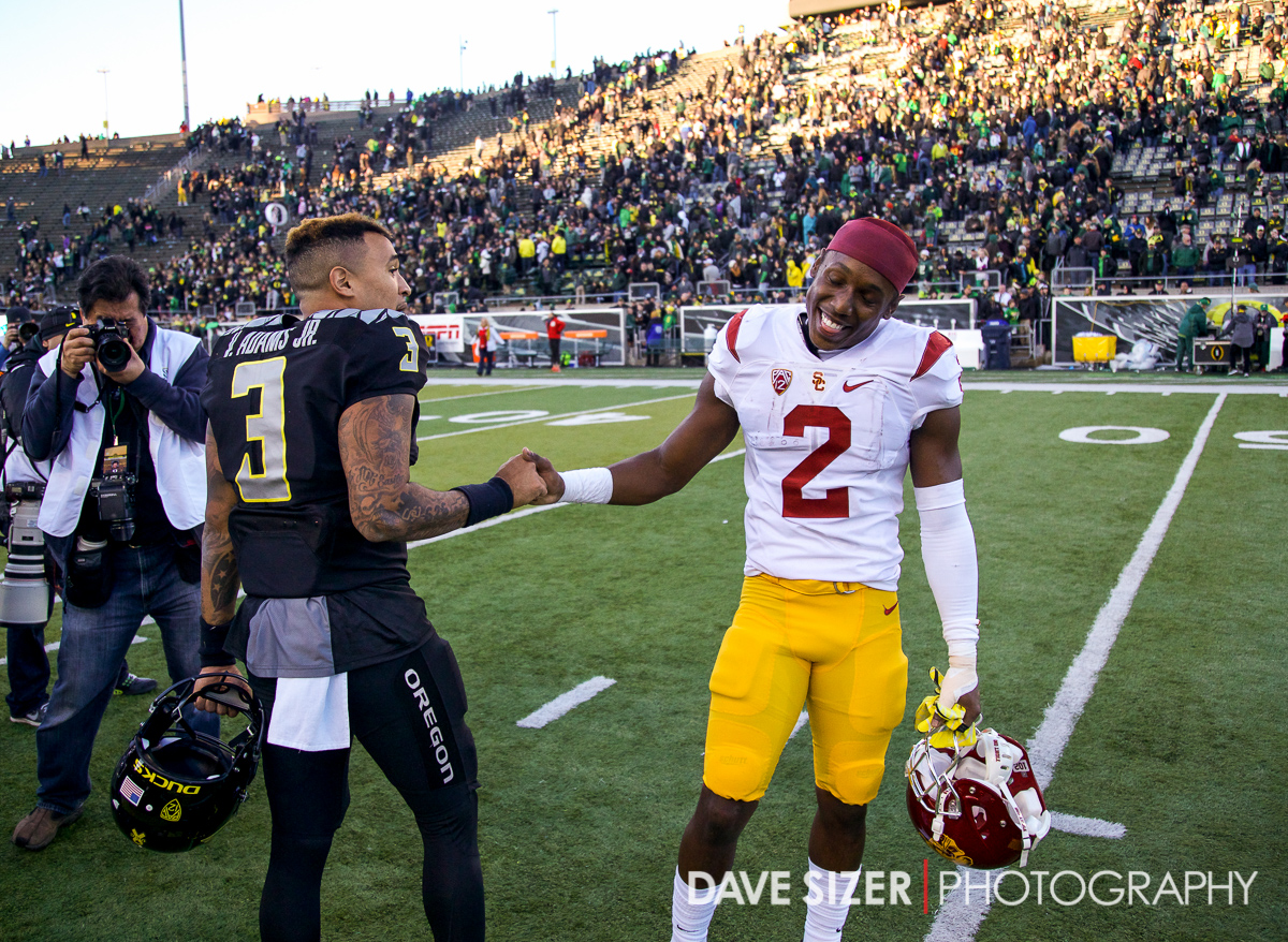 Vernon Adams and Adoree' Jackson chat after the game.