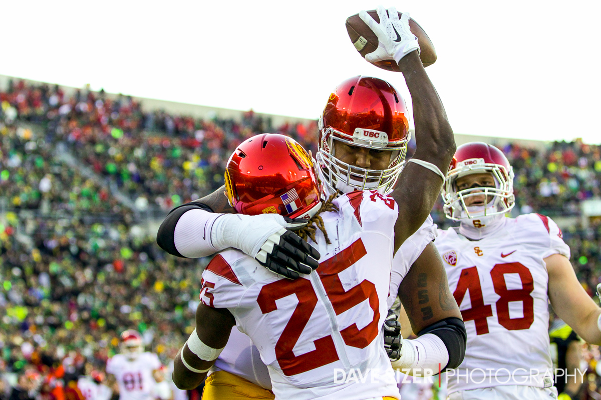 Ronald Jones celebrates his score with teammates.