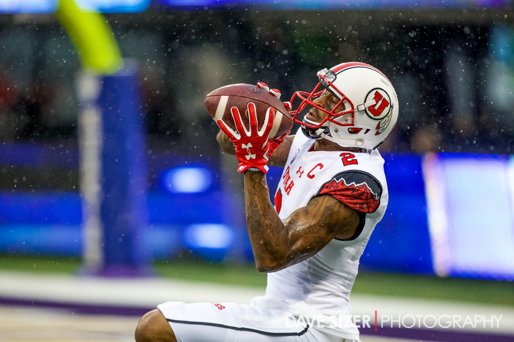 Utes WR Kenneth Scott hauls in a pass in the rain