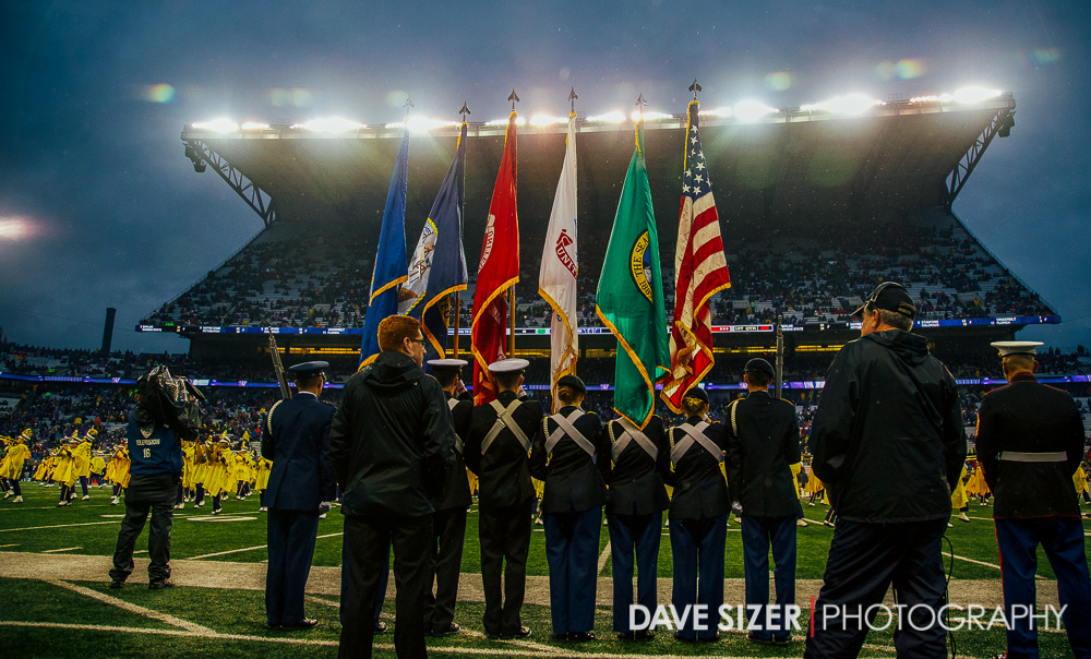 Members of the branches of the Military present the colors before the game.