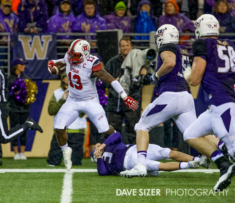 UW QB Jake Browning trips up Utah's Gionni Paul after an interception.