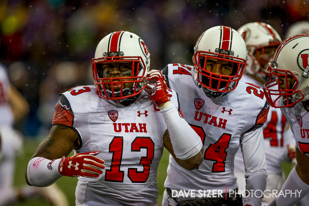 Utah's Gionni Paul is congratulated by teammates on the sideline after the pick.