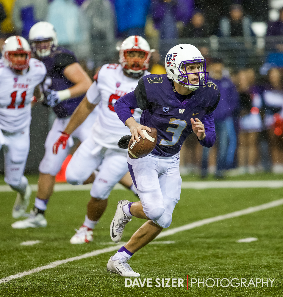 Jake Browning scrambles for yardage .