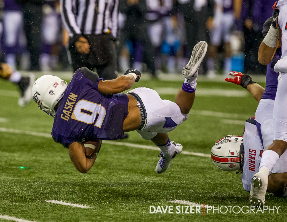 Myles Gaskin gets tripped up by a Utah defender.