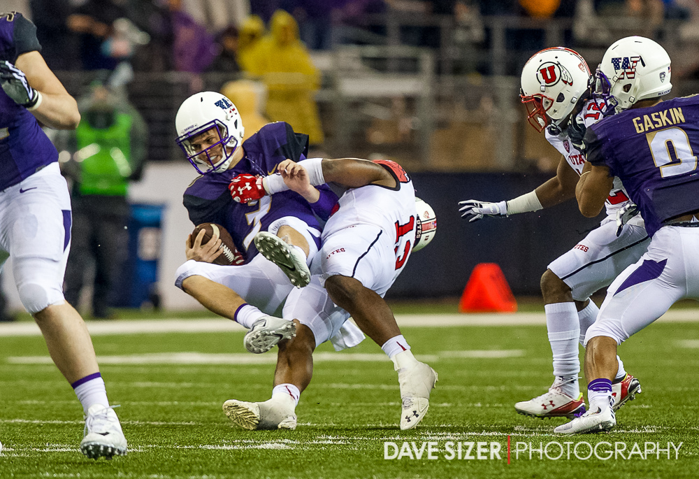 Jake Browning is thrown down by Gionni Paul for a sack.