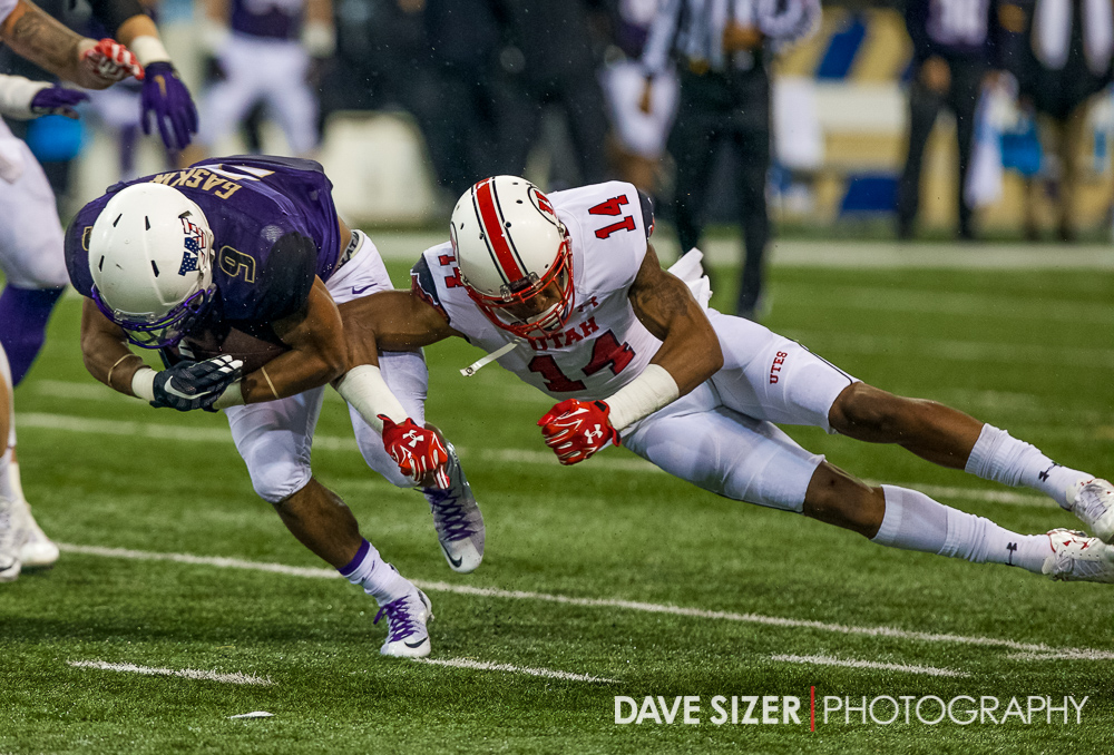 Utah's Brian Allen delivers a hit on Myles Gaskin.