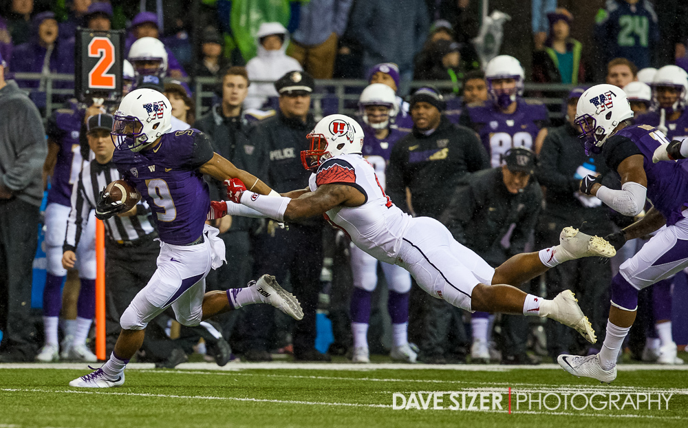 Myles Gaskin just out of the reach of  the Utes defender