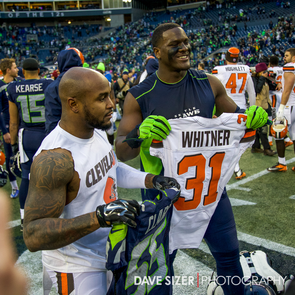 Frank Clark (Michigan) and Donte Whitner (Ohio State) swap jerseys after the game.