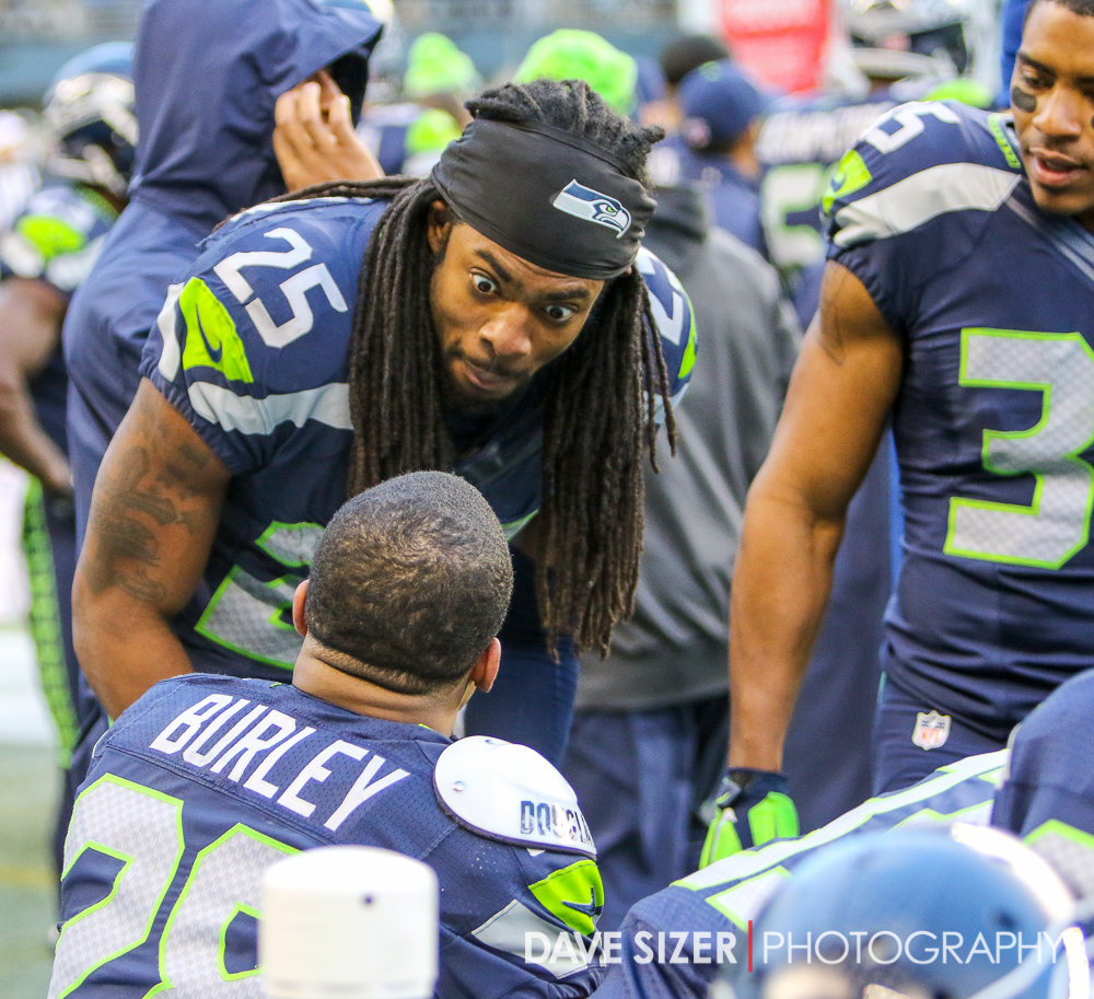 Richard Sherman talks with Marcus Burley after Burley's interception near the end of the game.
