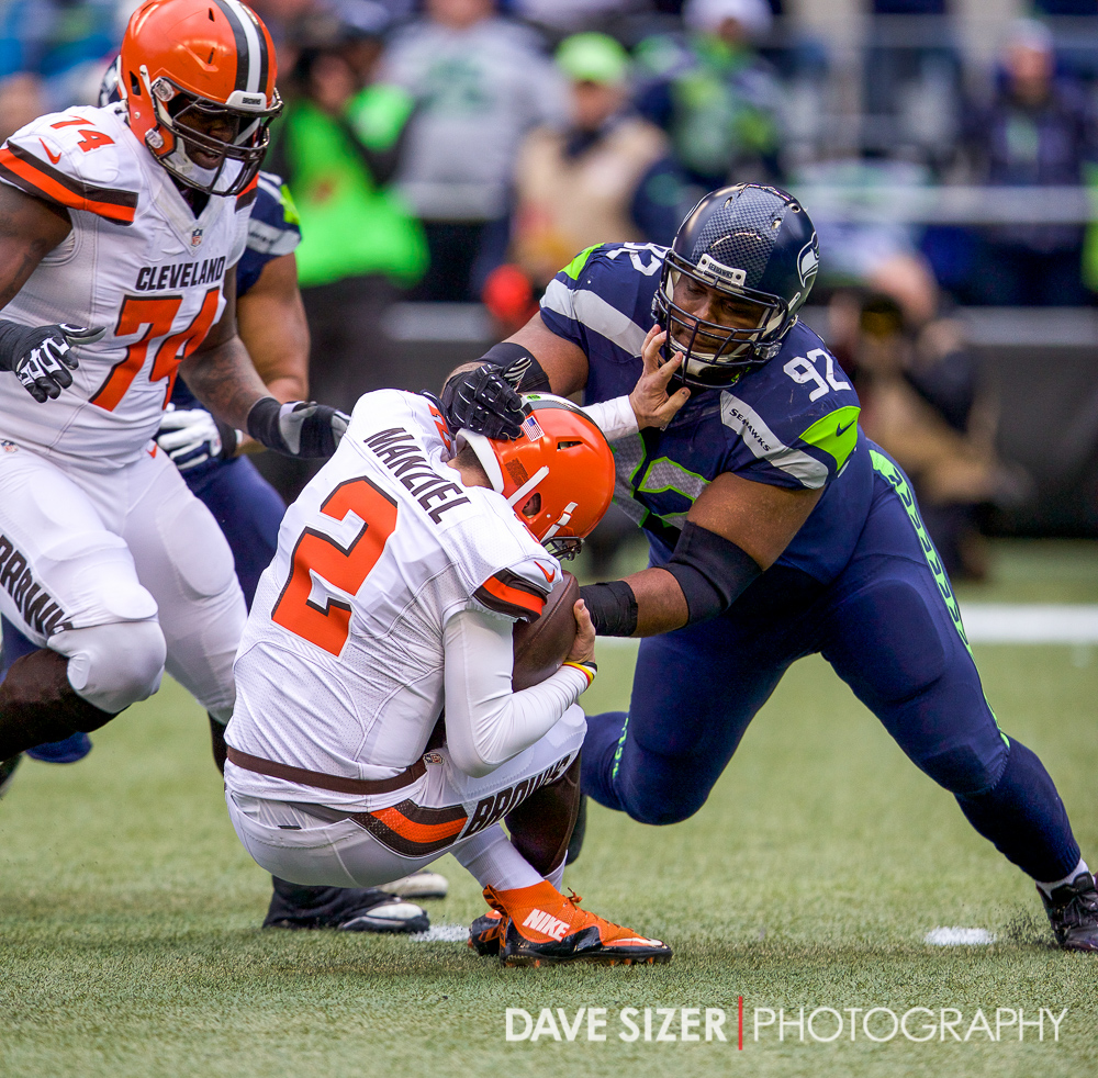 Brandon Mebane brings down Johnny Manziel for a sack.