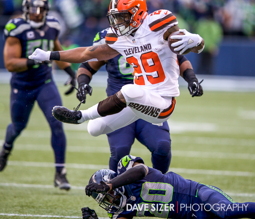 Duke Johnson leaps over Jeremy Lane.