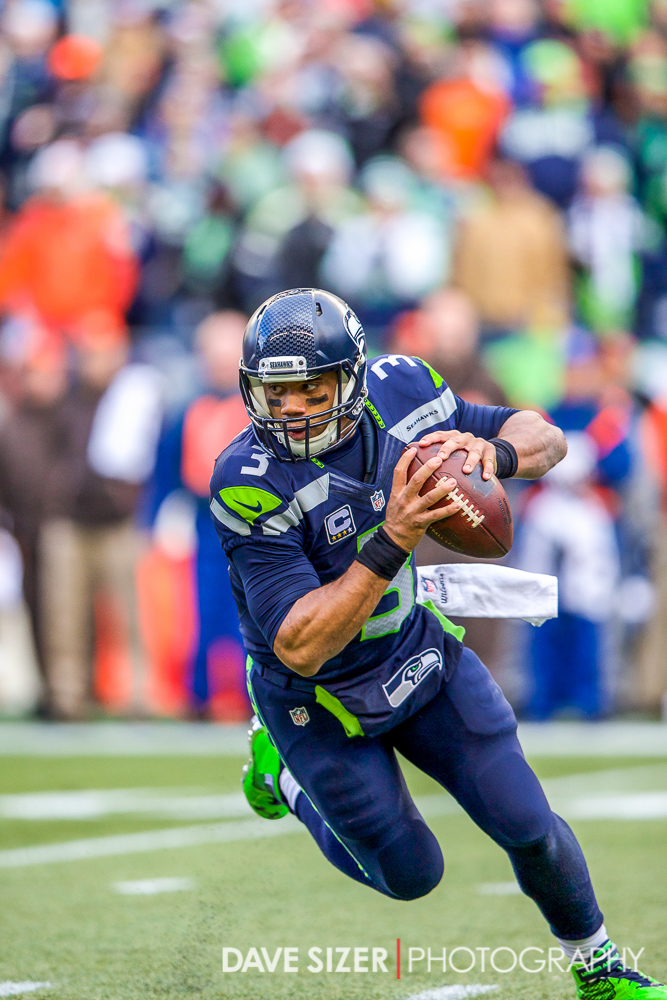 Russell Wilson scrambles for yardage.
