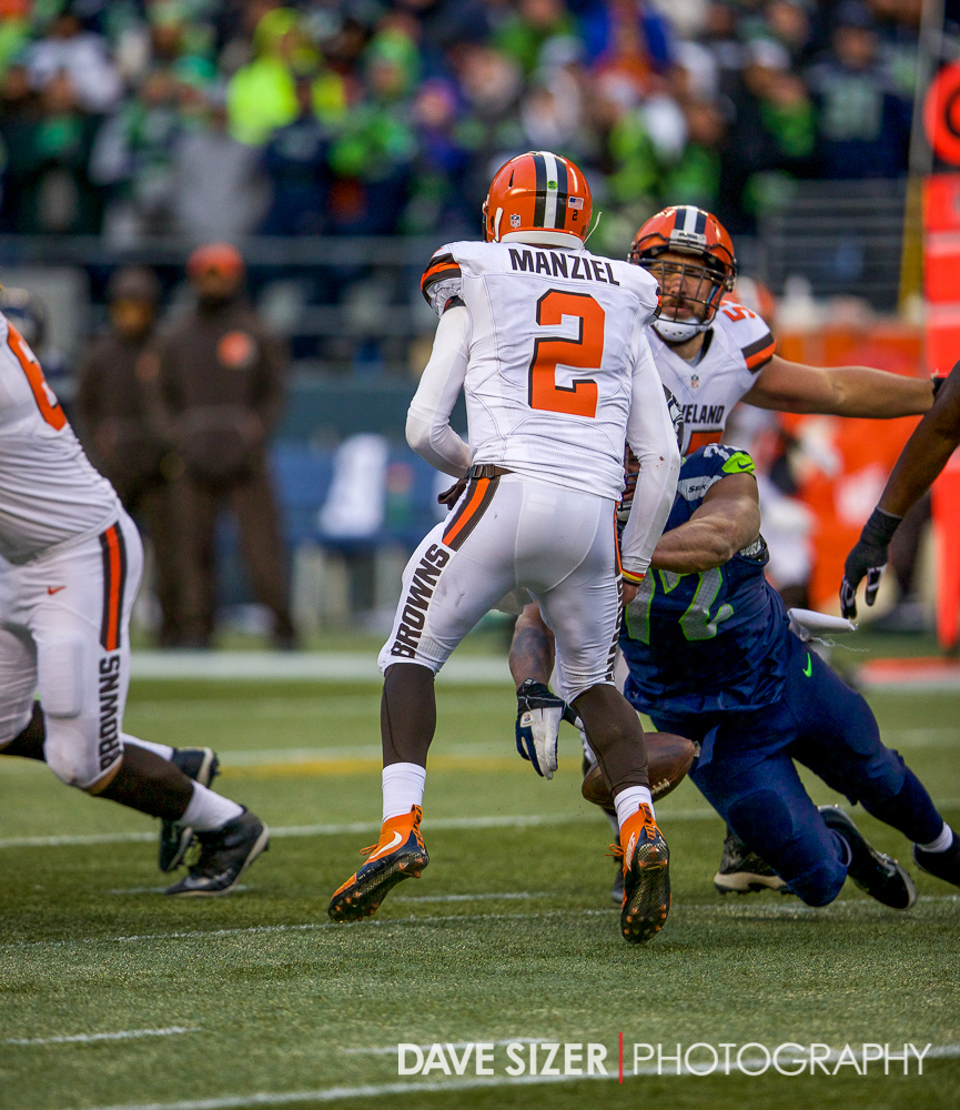 Michael Bennett strips Johnny Manziel for a fumble.