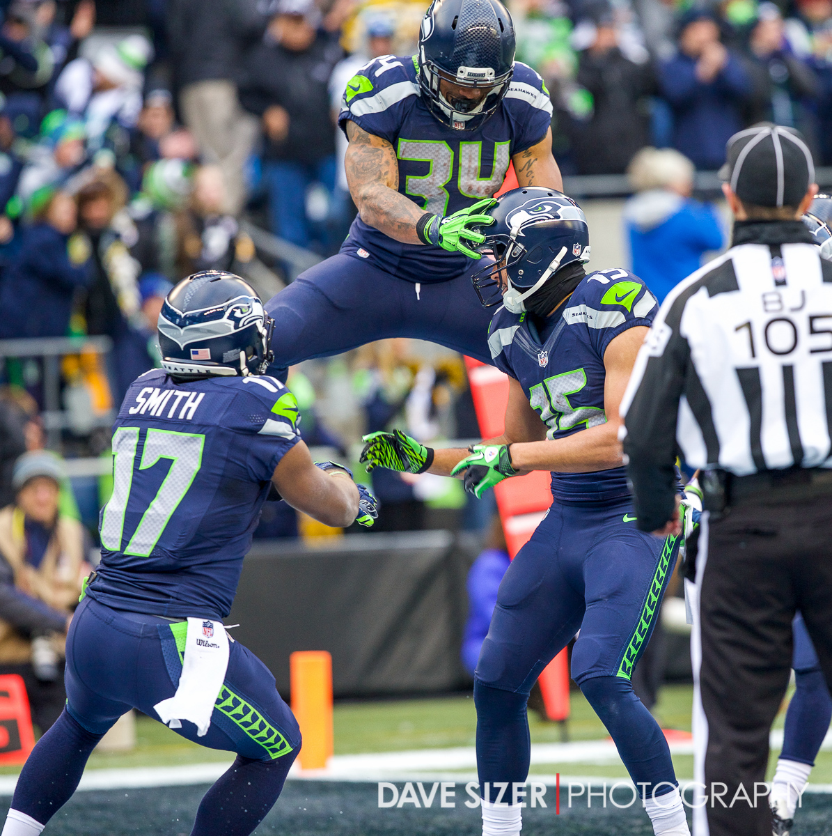 Thomas Rawls leaps in the air after Jermaine Kearse's touchdown.