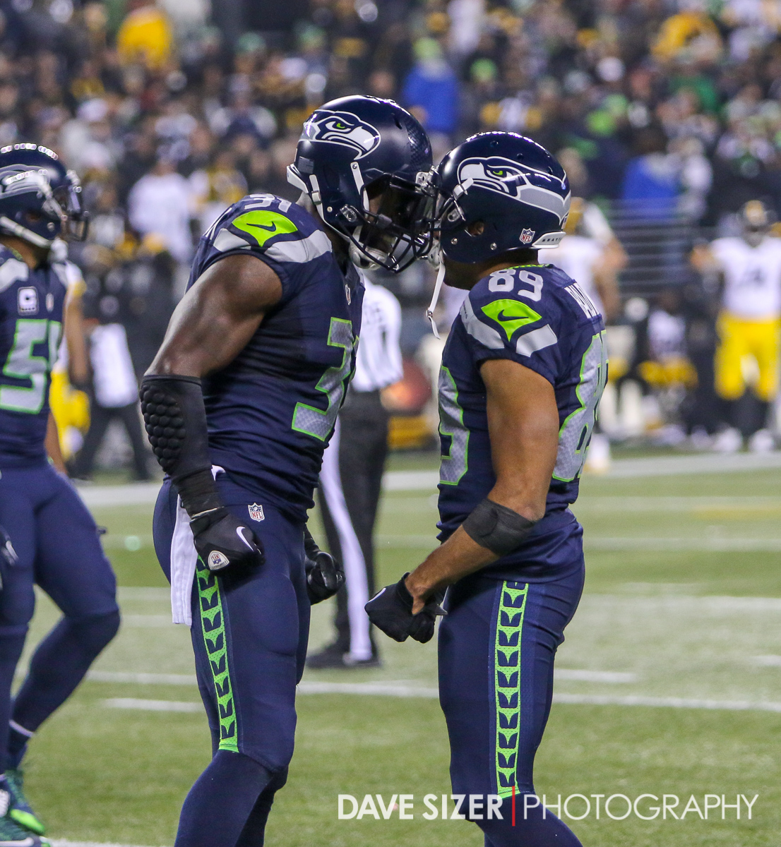Kam Chancellor congratulates Doug Baldwin after a score.