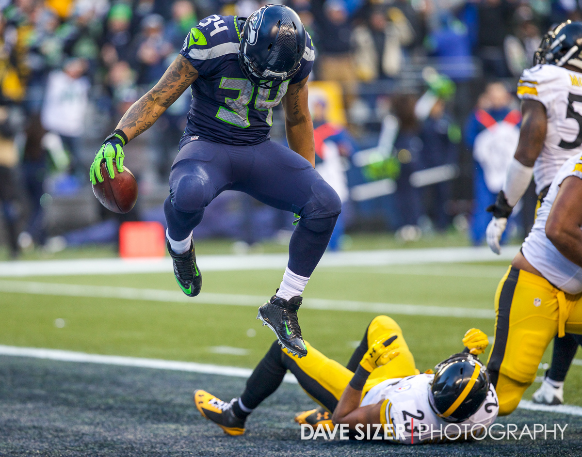 Rookie Thomas Rawls leaps in the air after scoring a touchdown.