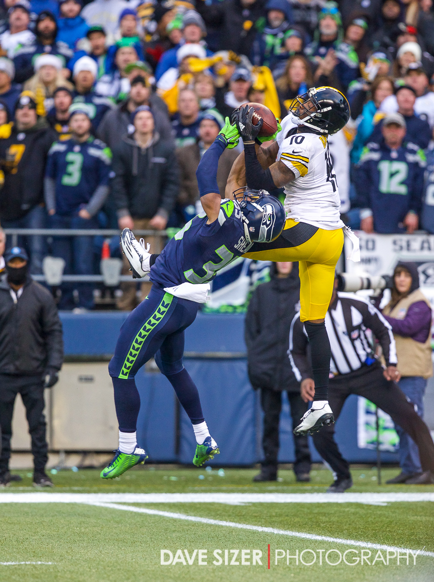 Martinis Bryant skies high for a grab, but the pass is broken up by DeShawn Shead.