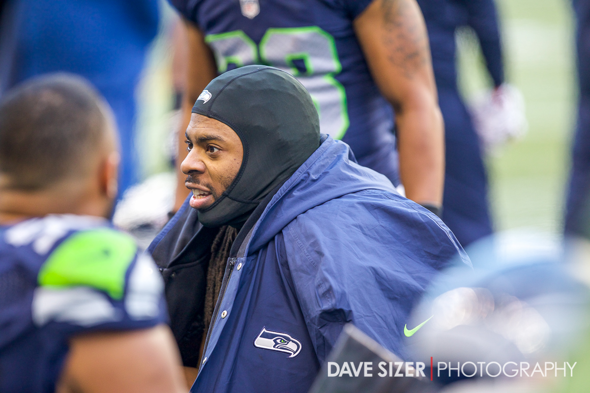 Richard Sherman talks with his defensive crew on the sidelines.