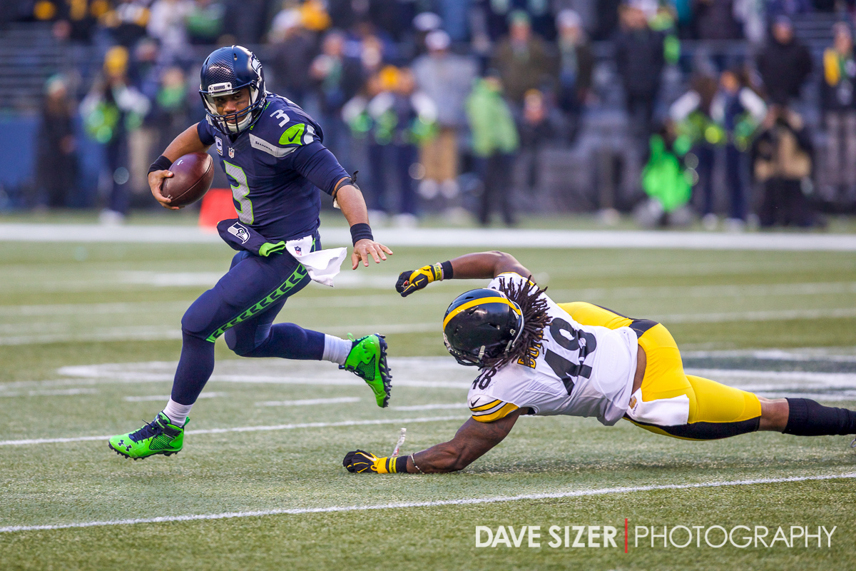 Russell Wilson scrambles to escape Bud Dupree