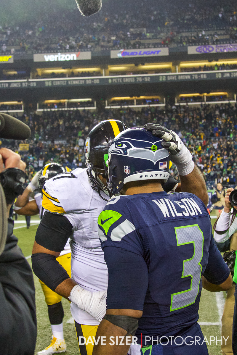 Russell Wilson and  Cameron Heyward chat after the game.