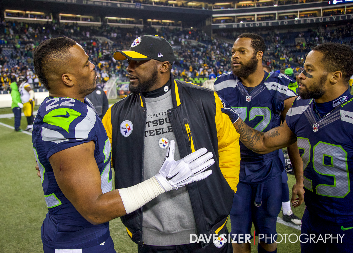 Fred Jackson and Earl Thomas chat with Pittsburgh head coach Mike Tomlin after the game.