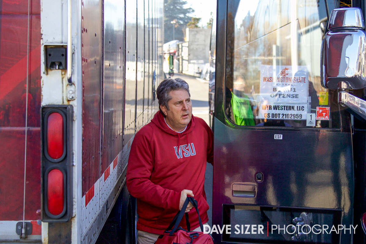 WSU Coach Mike Leach gets off the bus at the stadium.