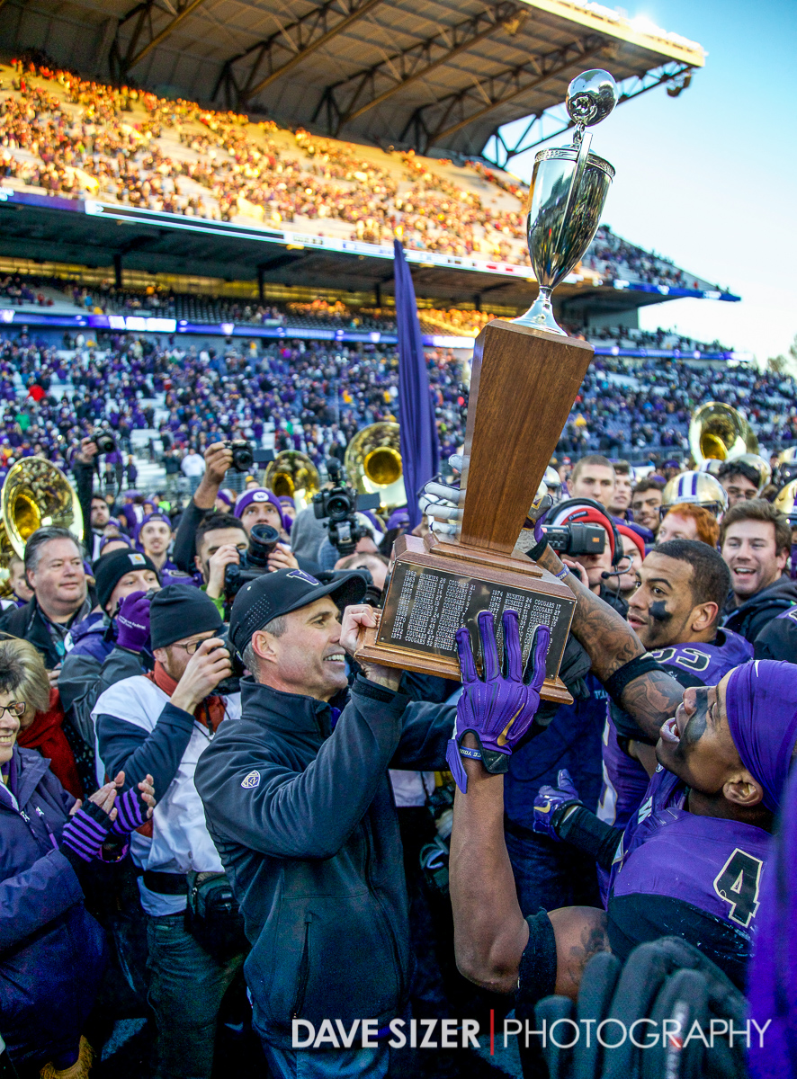 Coach Pete and the Huskies hoist the trophy.