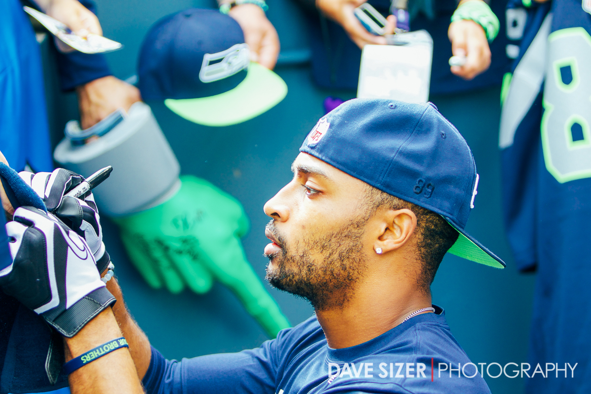 Doug Baldwin signs autographs after pregame warmups.