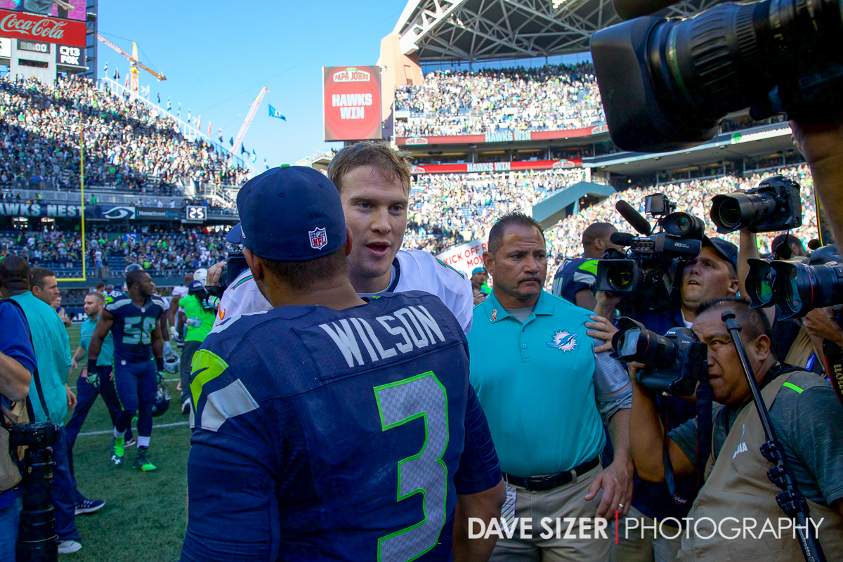 The two quarterbacks shake hands after the game.