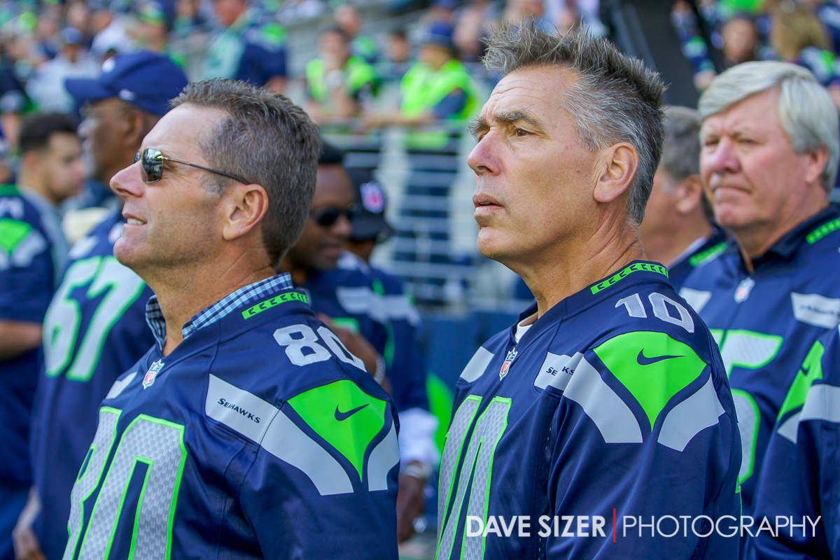 Steve Largent and Jim Zorn on the sidelines for a halftime ceremony.