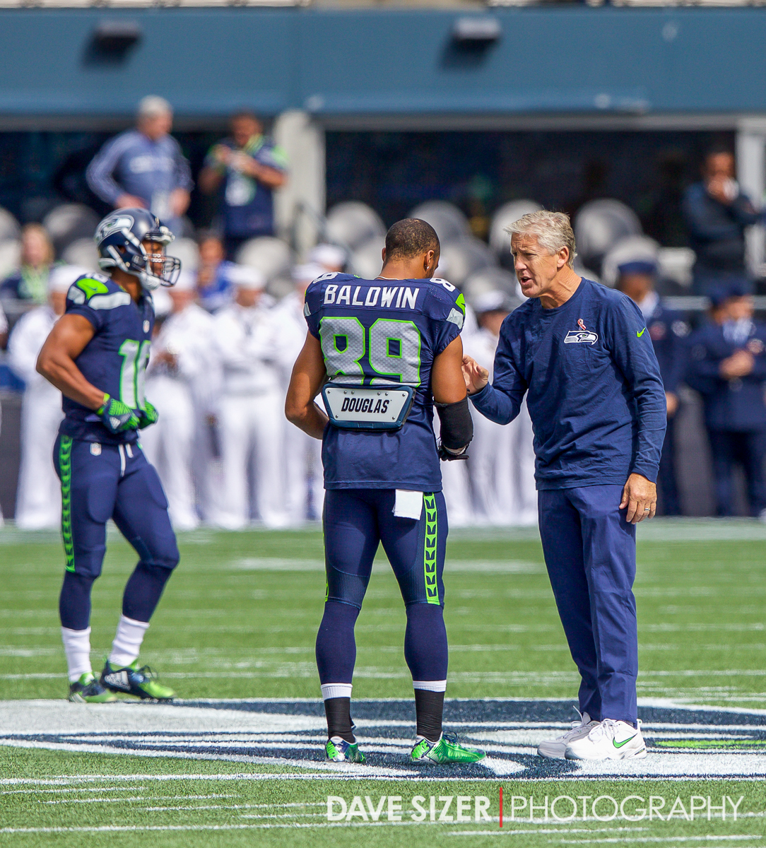 Coach Pete Carroll talks with Doug Baldwin before the game.