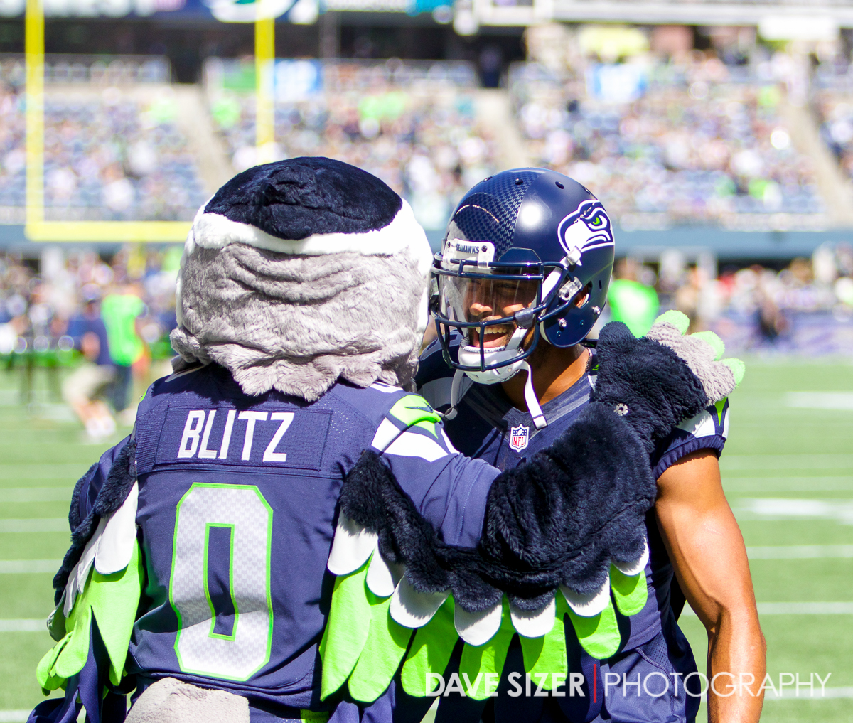 Doug Baldwin laughs with Blitz during pregame.