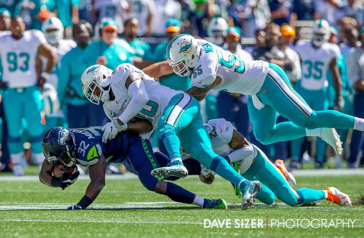 Christine Micheal gets gang tackled by the Miami defense.