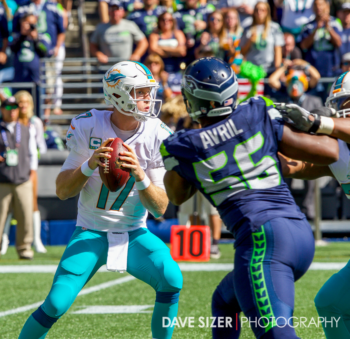 "Ryan Tannehill with the ""oh Sh*t!"" look on his face as Cliff Avril closes in."