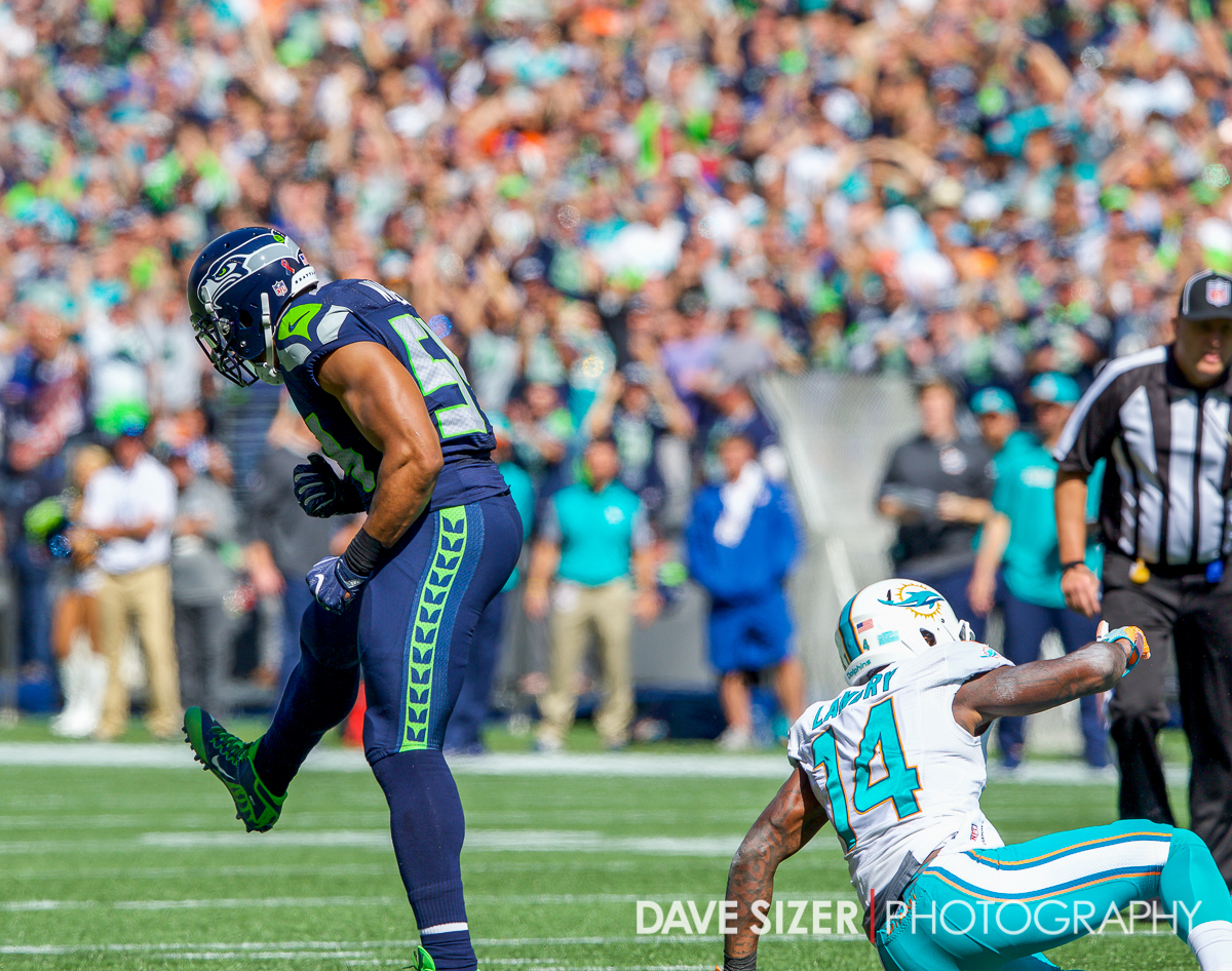 Bobby Wagner celebrates after stopping Jarvis Landry for a loss.