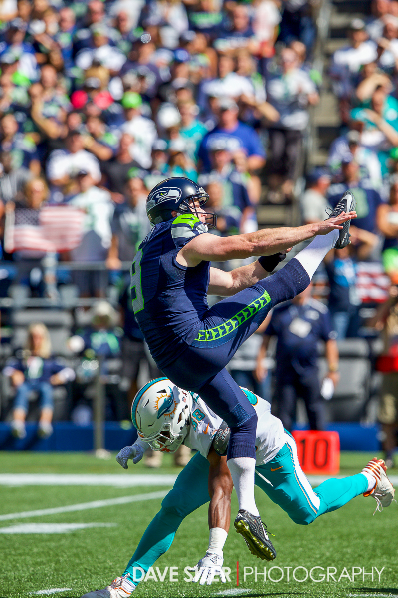 Jon Ryan gets off a kick under pressure.
