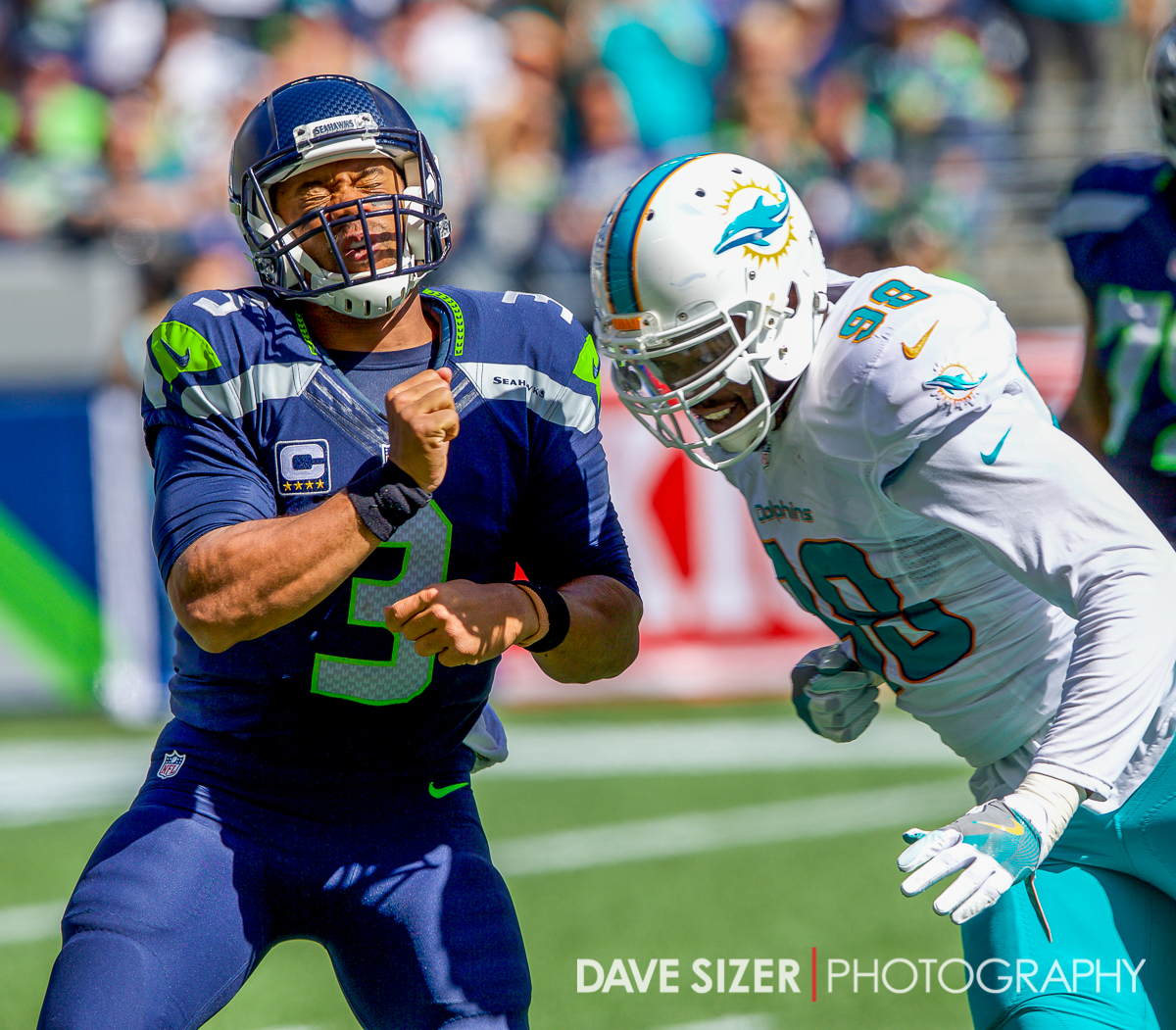 Russell Wilson takes a shot after just getting a pass away.