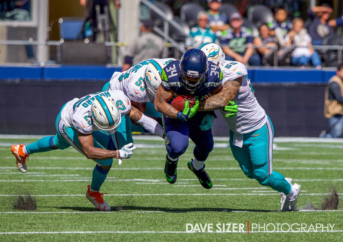 Thomas Rawls plows through the Dolphin defense.