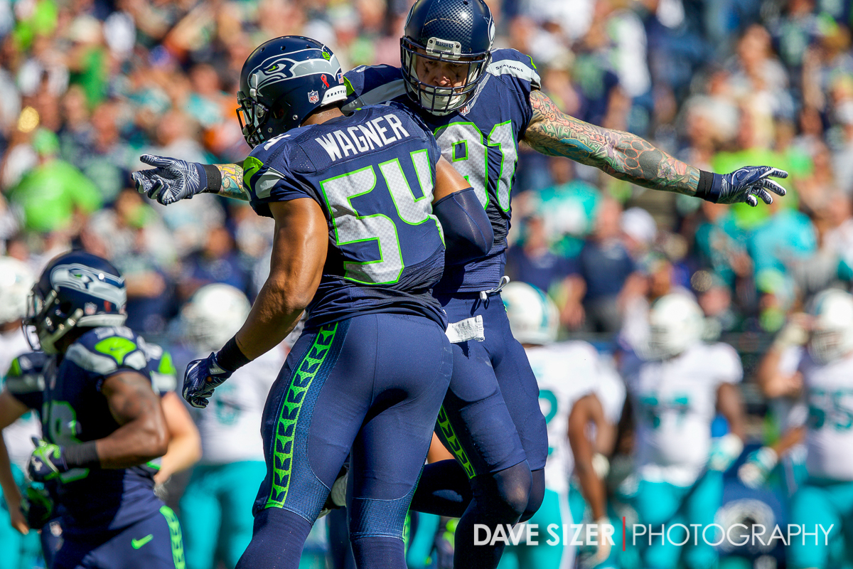 Bobby Wagner and Cassius Marsh celebrate after a stop.