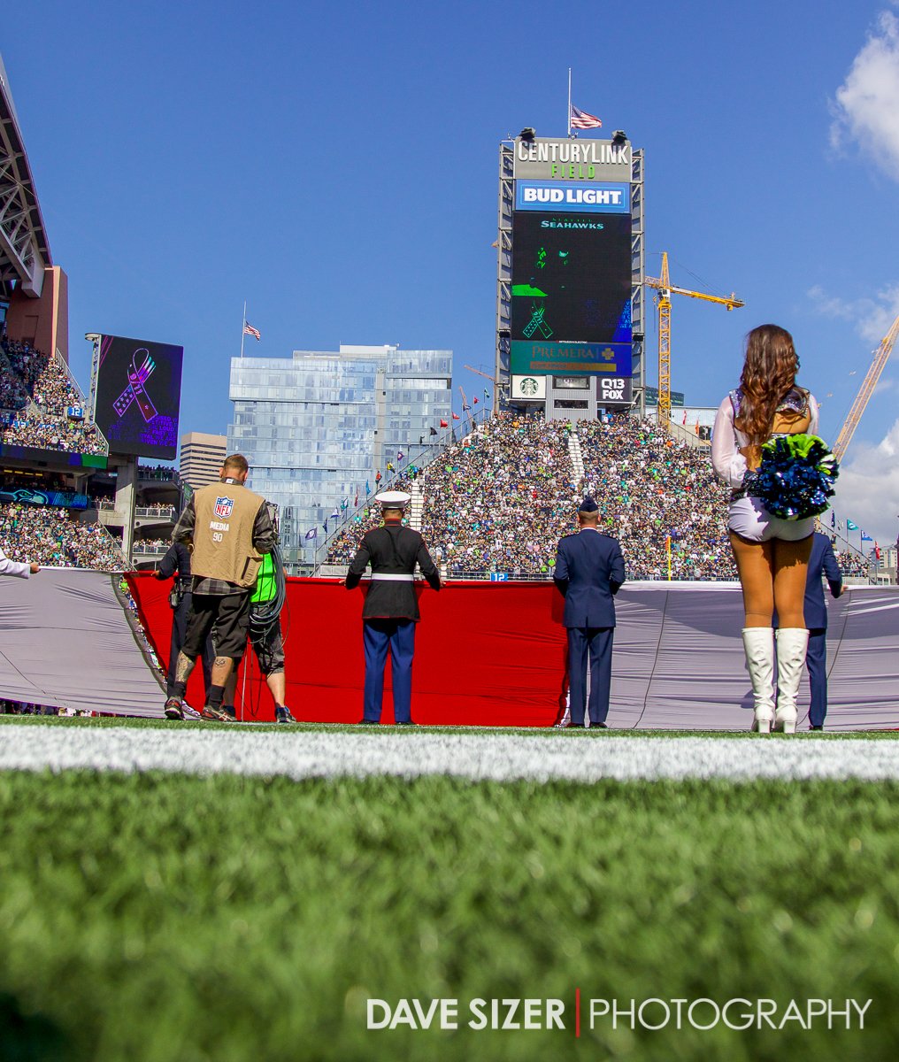 The color guards and cheerleaders during the National Anthem.