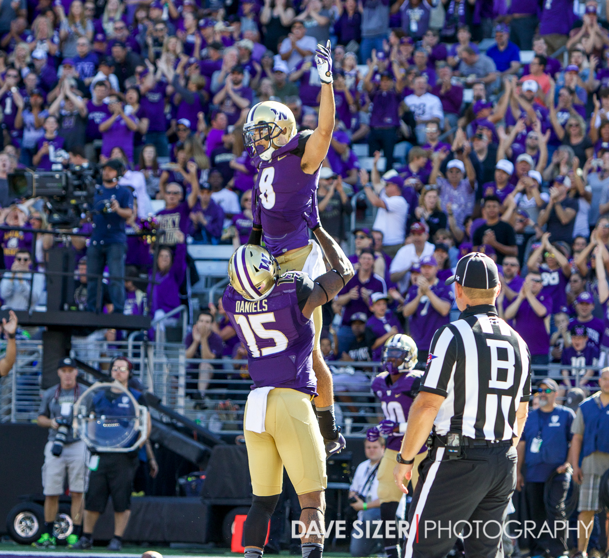 Darrell Daniels lifts up Dante Pettis after a touchdown.