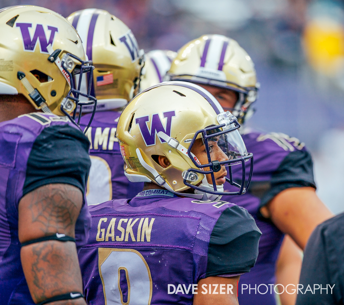 Myles Gaskin peeks back out of the huddle.