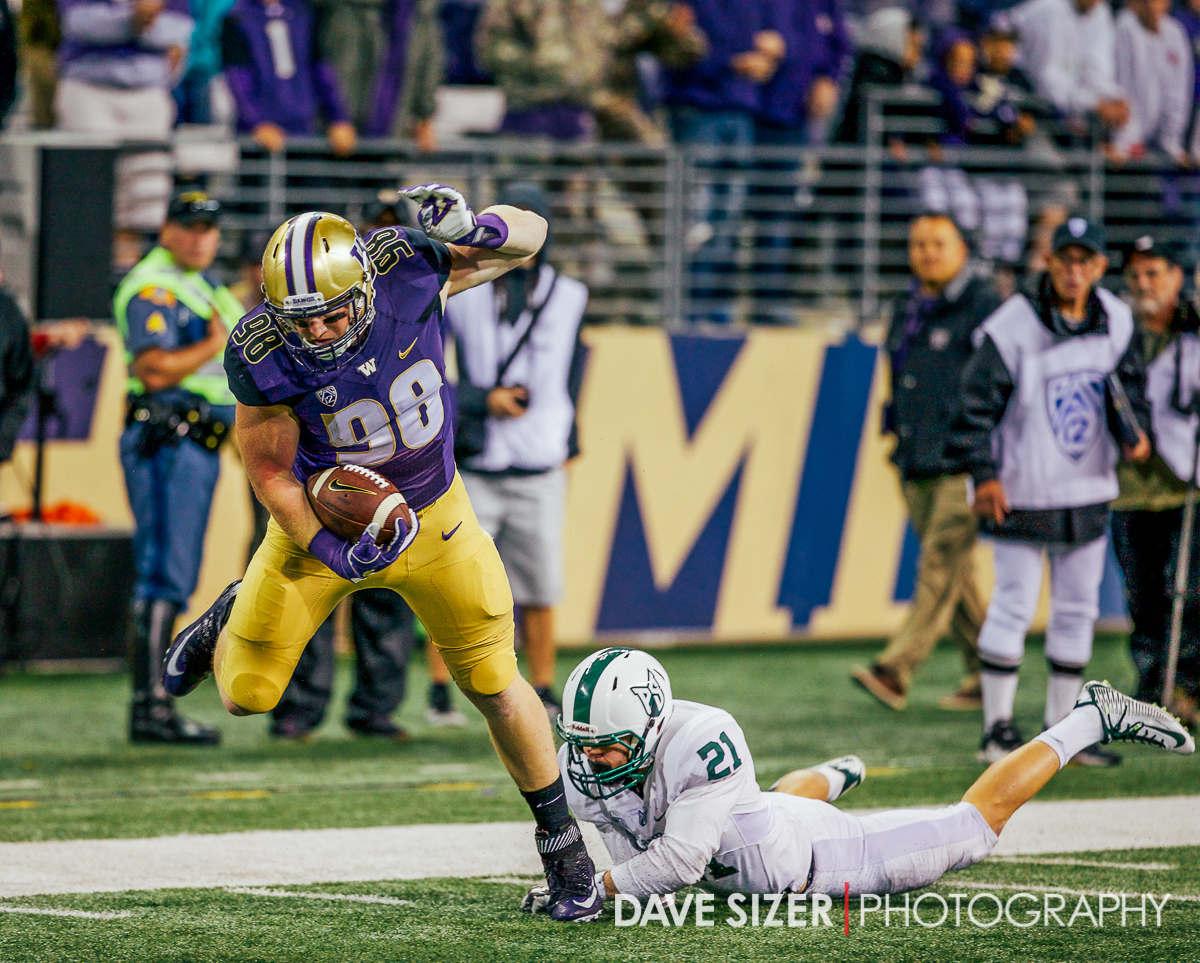 Tight End Will Dissly hauls in a touchdown near the end of the game.