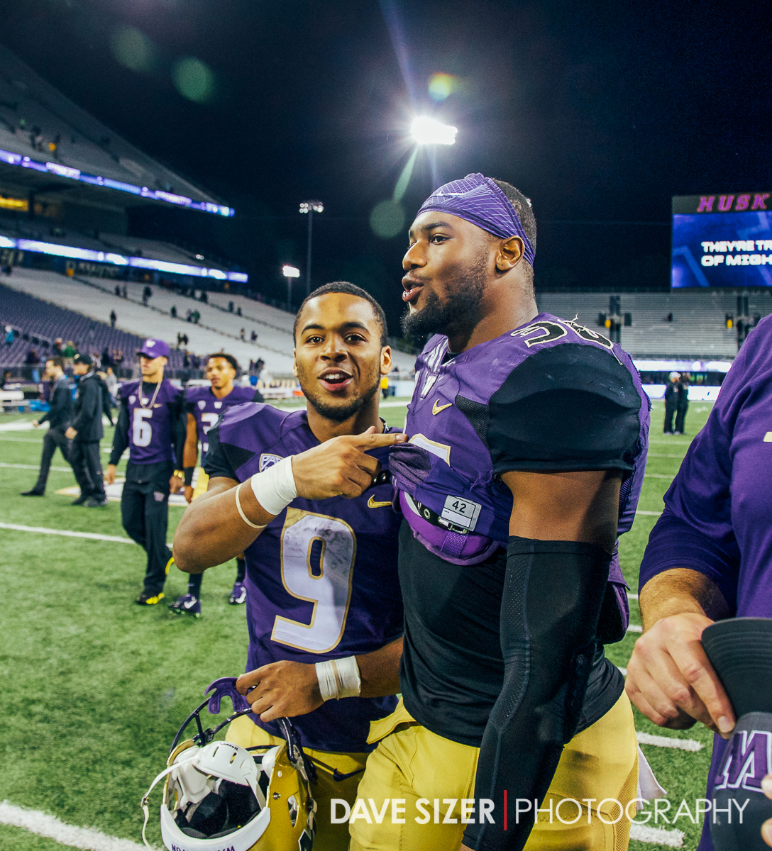 Myles Gaskin and Akeem Voctor walk off the field victorious.