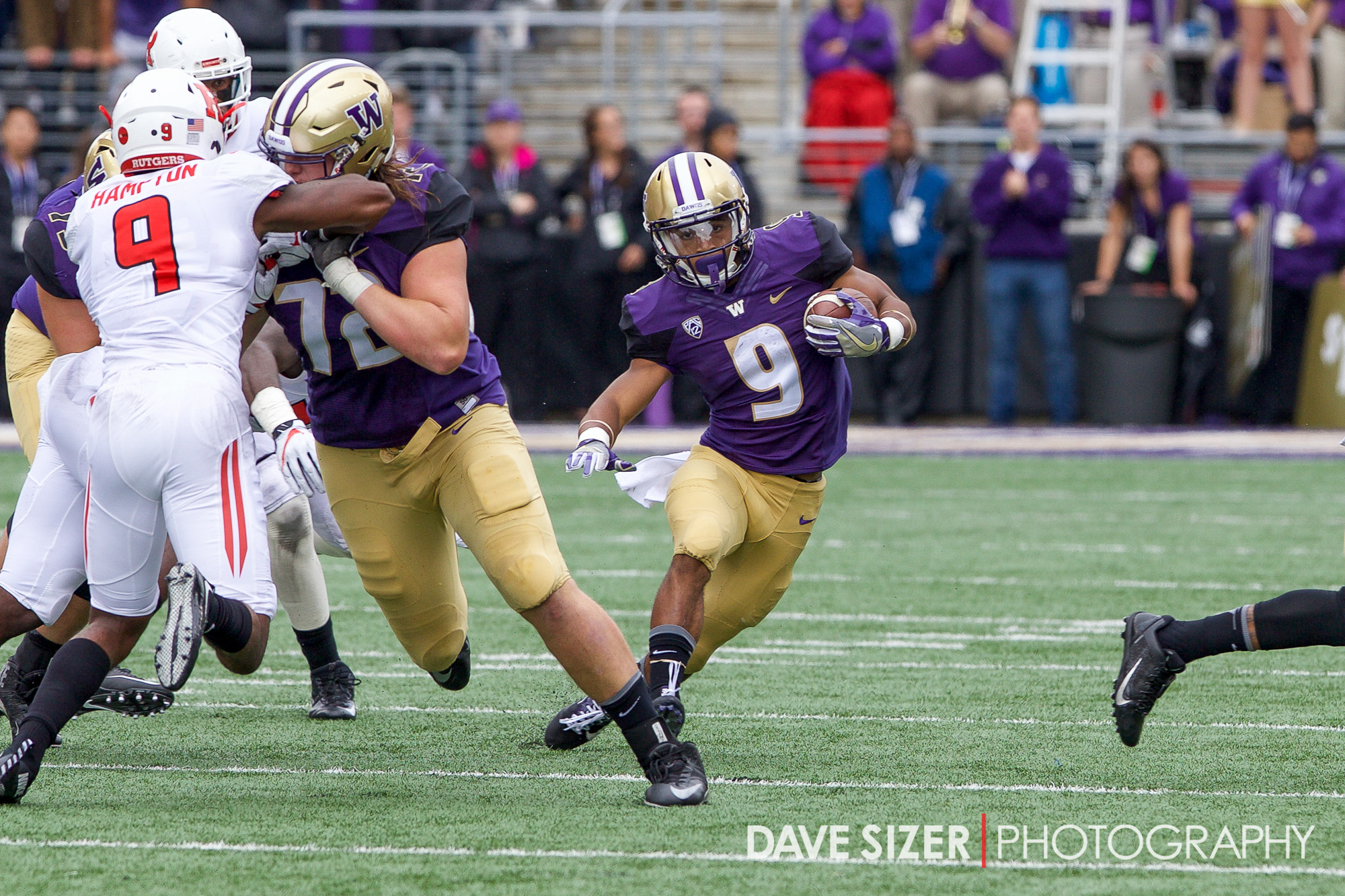 Myles Gaskin cuts around his blocker for yardage.