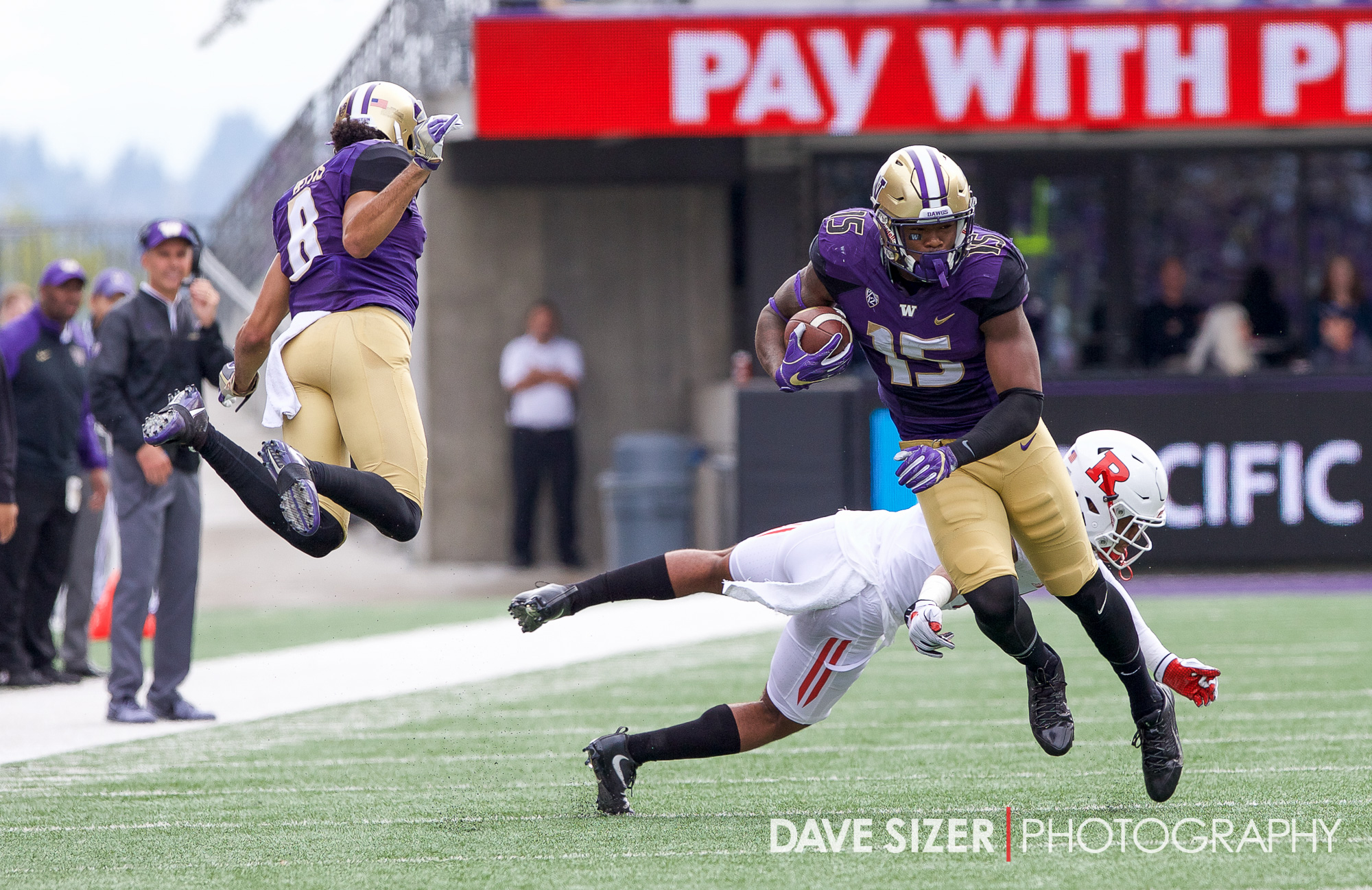 Darrell Daniels runs upfield as Dante Pettis tries to get out of the way.
