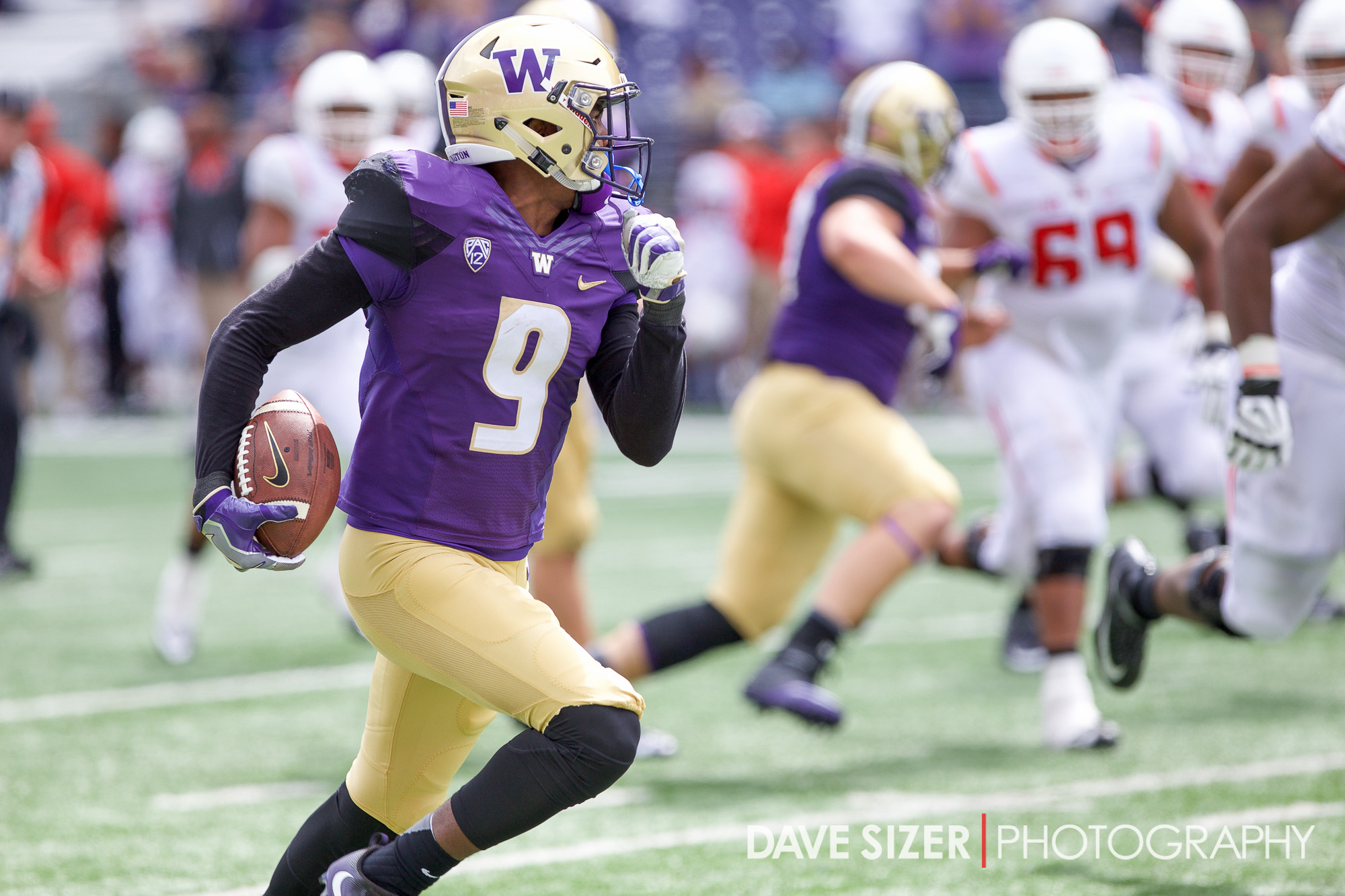 UW Safety Brandon Beaver runs back an interception almost to the end zone, but is stopped just short.