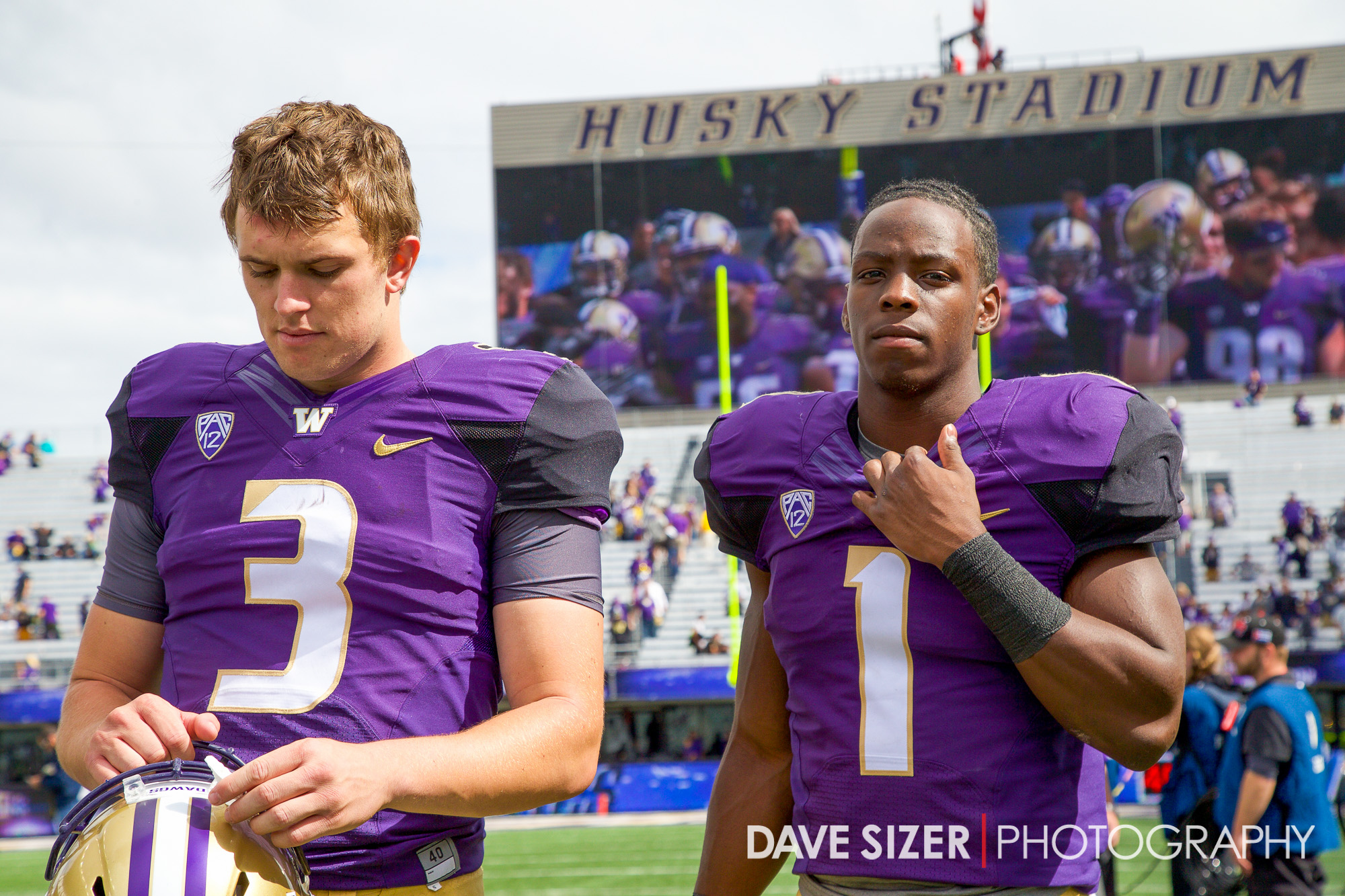 Jake Browning and John Ross wait after the game for their TV interviews.